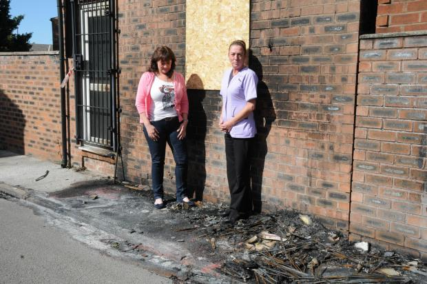 Mandy Richardson and Cath Appleby inspect the damage