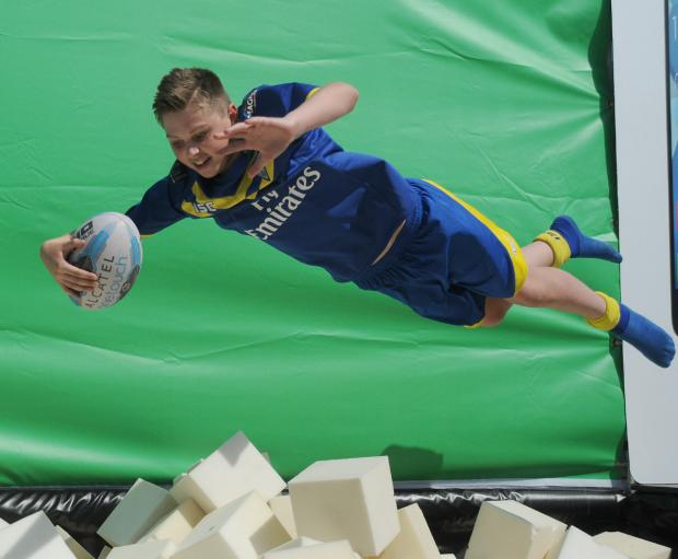 Taylor Clare, aged 14, doing his best impression of Joel Monaghan in the fan zone at the Magic Weekend. Pictures by Mike Boden