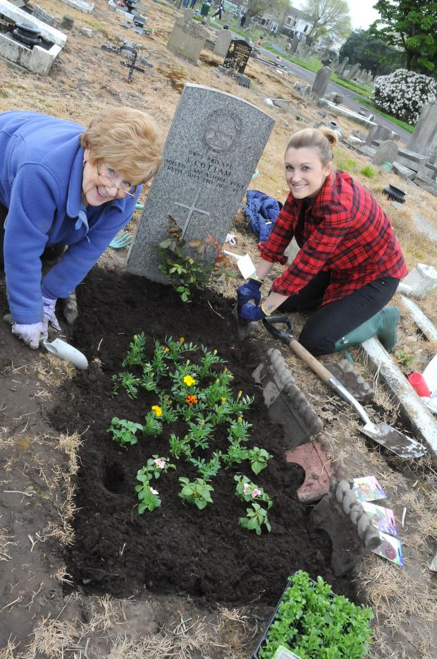 Warrington Guardian: Youngsters help clear war graves at Warrington Cemetery