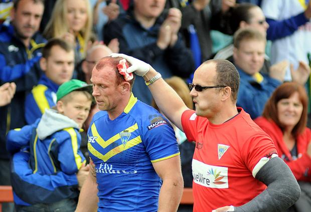Micky Higham leaves the Wakefield pitch with a head cut