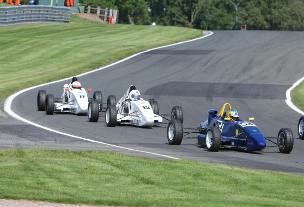 Dougie Crosbie  (blue and yellow car 54) leads David McArthur (white car 15) and Tom McArthur (white car 17) through Cascades. Picture by Eddie Whitham