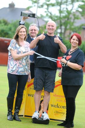 Bill Lee, centre right, with fellow slimmers Michelle Jones and Kerrie Brettle who lost 50lbs between them in six weeks with Malcolm Kindon from St Rocco's Hospice behind them