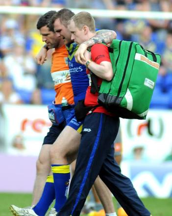 Ben Evans is helped from the field after injury