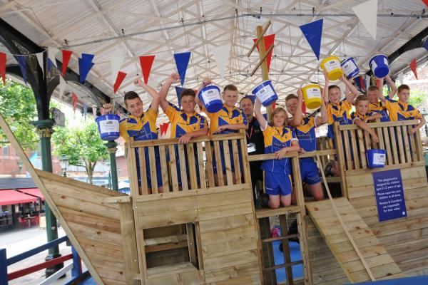 Member from Crosfields rugby team help launch the new adventure playground