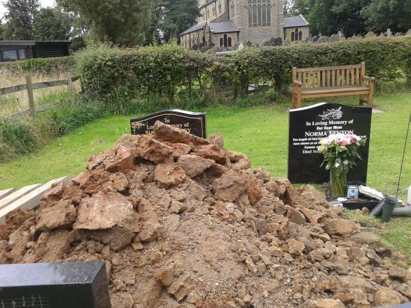 Distraught daughter sad at mother's grave in Culcheth