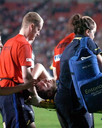 Simon Grix is stretchered off in the first half. Picture MIKE BODEN