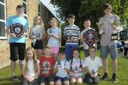 Swimmers at Penketh pool on Honiton Way received a variety of prizes.  ip11714