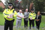 Insp Neil Drum with, from left, Clr Peter Carey, Clr Tony Higgins, CSO Daren Wood and Kathy Sephton, from Warrington Borough Council  MBEE120914