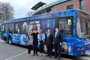 Students Andrea Norris-Webb and Ben Craven with Sarah Storey, Ian Howard and Gareth Hughes from Springfield bus company