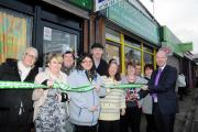 Cllr Tony Higgins opening the new charity shop with staff and users  shop_opening_mba260115.jpg