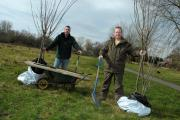 Vinny Higham and Jamie Gardner getting ready to plant the trees
