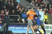 Ben Evans is carried off at St Helens. Picture: MIKE BODEN