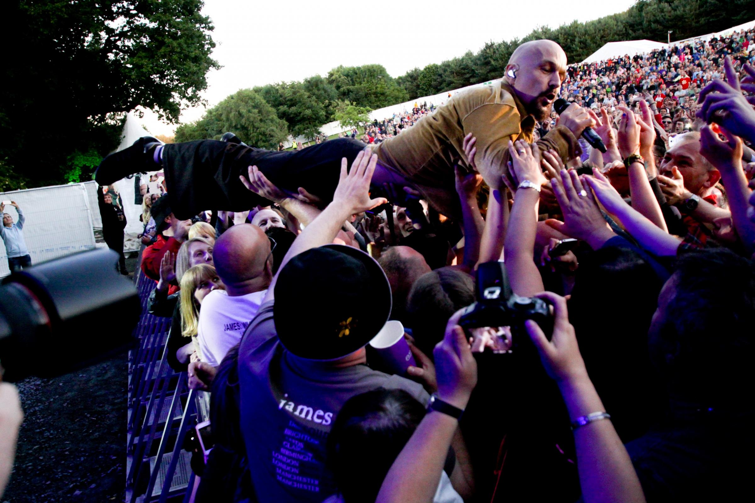 Tim Booth during his stage dive. Picture: Matt Sayle