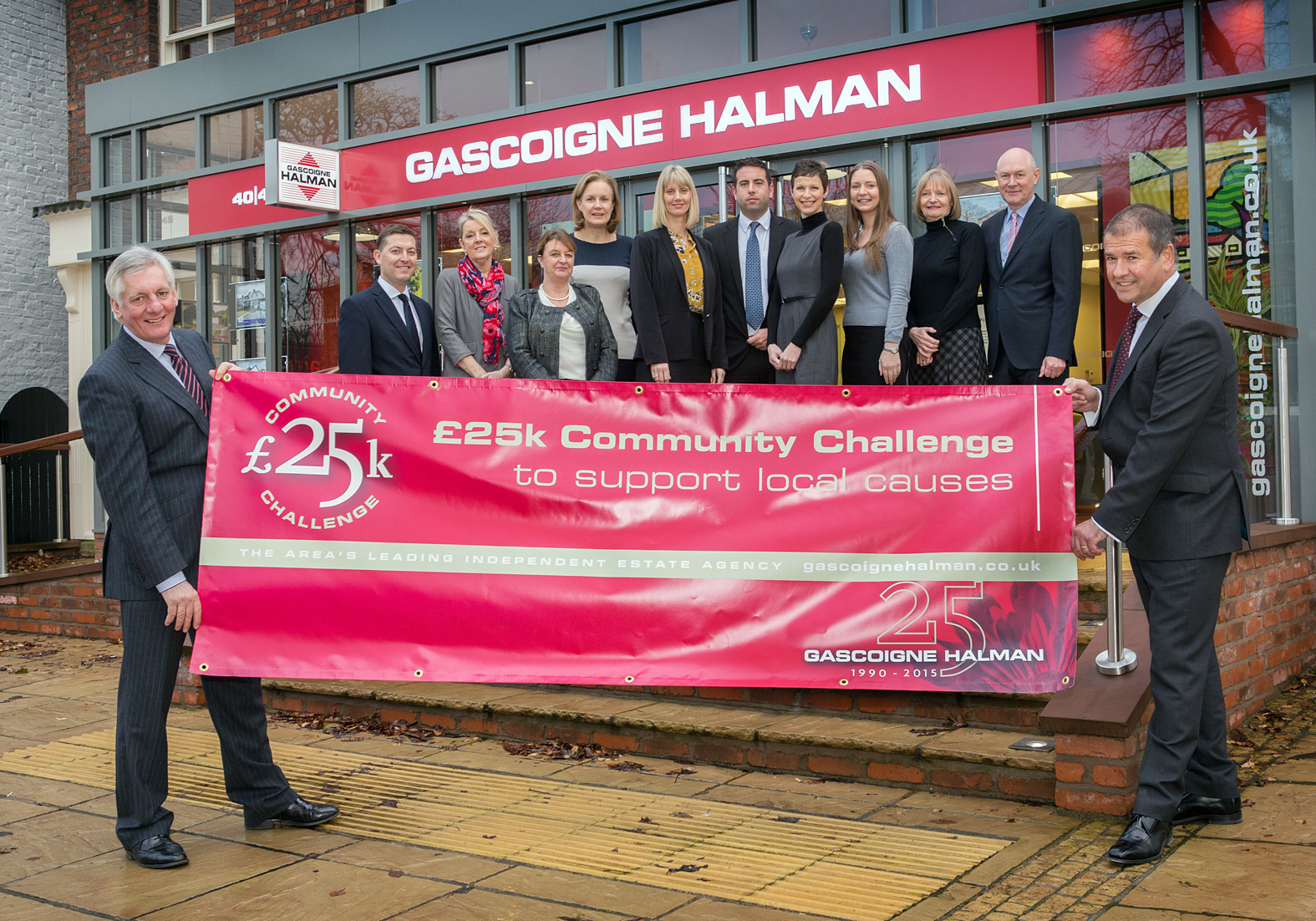 Gascoigne Halman's managing director John Halman and operations director Peter Higham with the estate agent's Wilmslow team