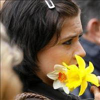 A woman stands in silence during the rally in Royal Square, Jersey
