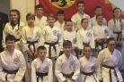 New black belt students and the grading panel members at Evans House