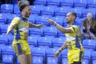 Warrington Wolves winger Kevin Penny celebrates with Gene Ormsby after bagging a try in the preseason victory over Leigh Centurions.