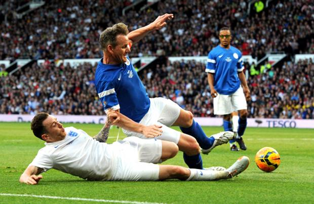 Warrington Guardian: FOOTBALLER: Danny Jones tackles Gordon Ramsay during Soccer Aid, 2014