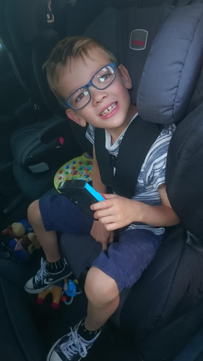 Seven Year Old Dylan James In His New Specialist Car Seat Which Was