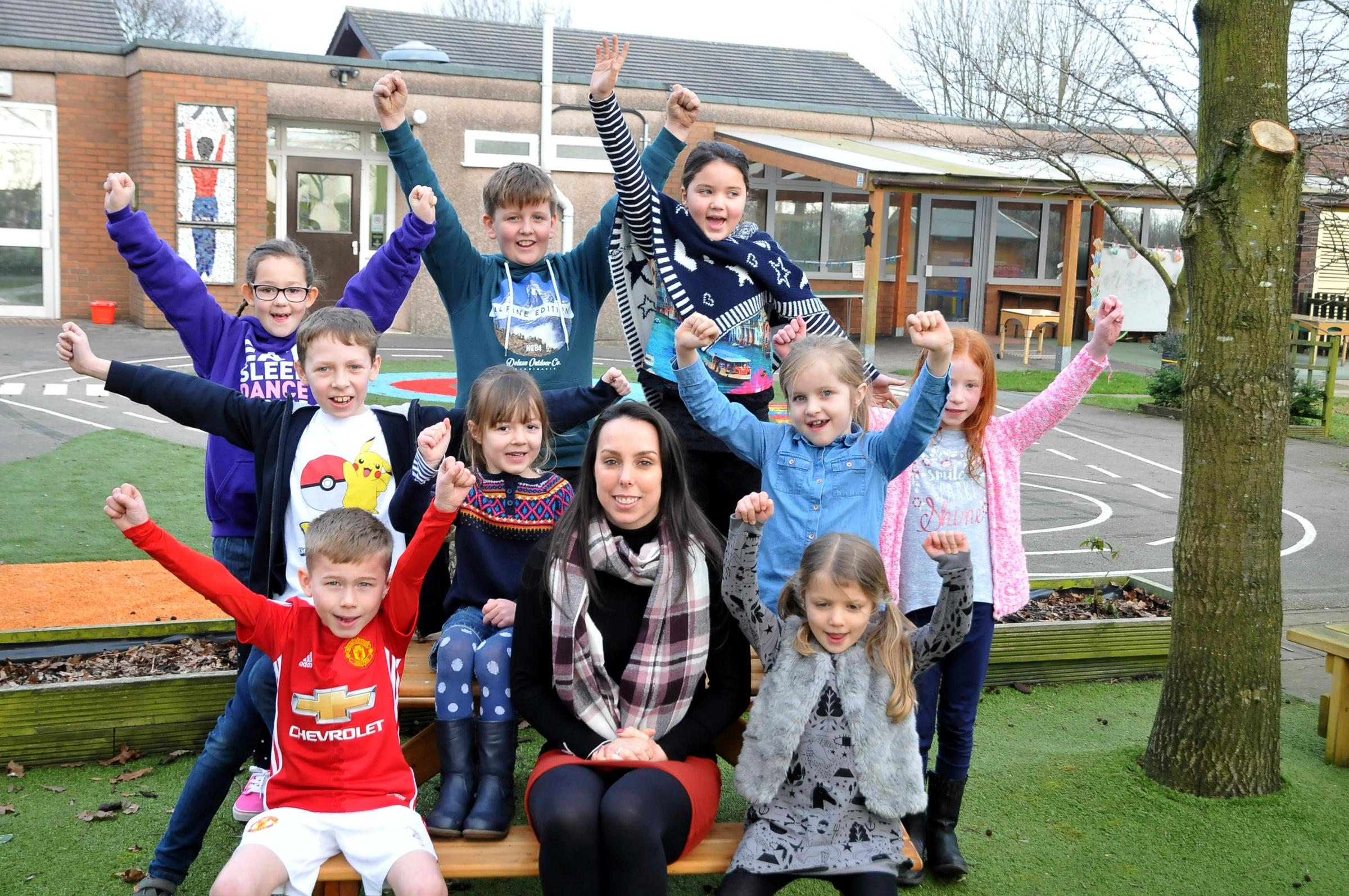 Beth Tweddle with youngsters at the school
