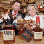 Warrington Guardian: Institution, Treasury Building, Palmyra Square BBQ, bourbon and cigar masterclass at Institution..Pic of general manager Sharon Johnson with bottles of bourbon for a preview with  Seb Szabla...