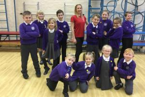 Becky Williams with pupils at the Latchford school