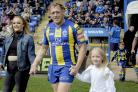 Ben Westwood and daughters Tyler and Grace lead The Wire out against Catalans on his 400th club appearance