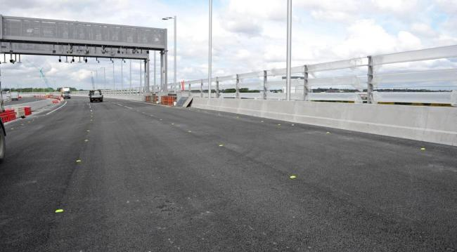 Automatic number plate registration cameras on a toll gantry will identify every vehicle that crosses over the bridge