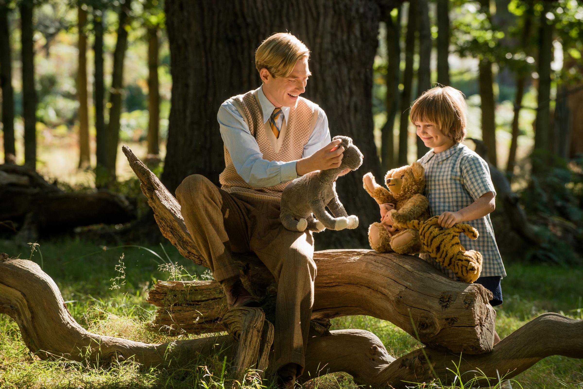 Domhnall Gleeson as Alan Milne and Will Tilston as Christopher Robin Milne
