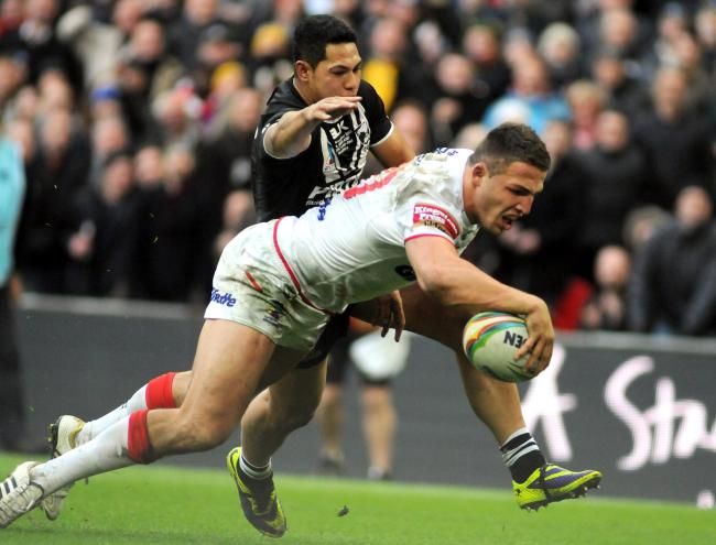 Sam Burgess scores for England against New Zealand in the 2013 Rugby League World Cup semi final at Wembley Stadium. Picture by Mike Boden