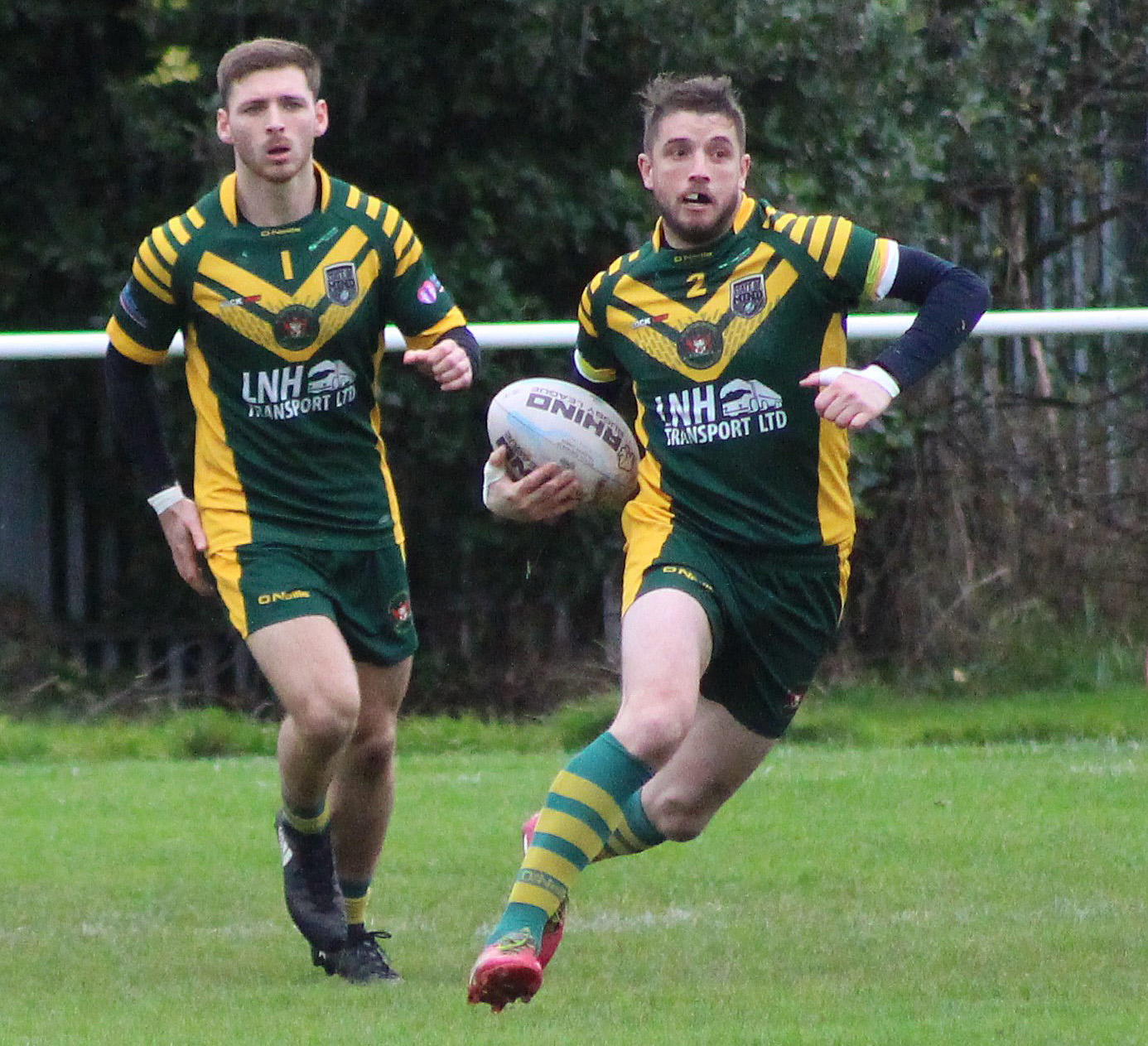 Try-scorer Alex Dunne takes the ball forward for Woolston Rovers