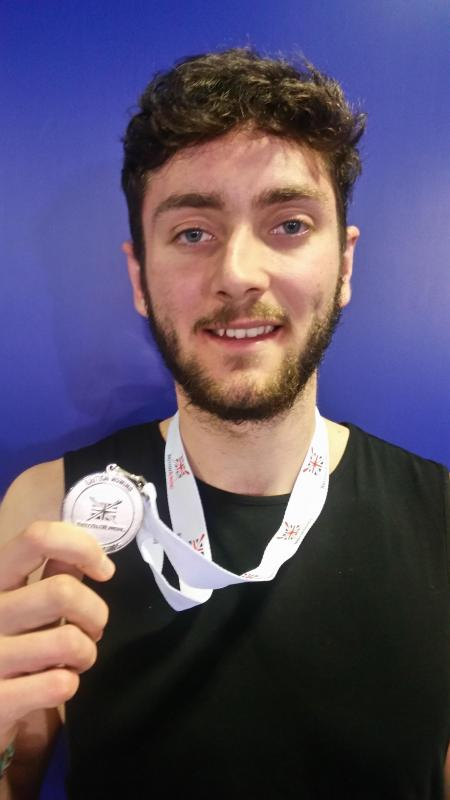 Alastair Eaves with his silver medal from the British Rowing Indoor Championships