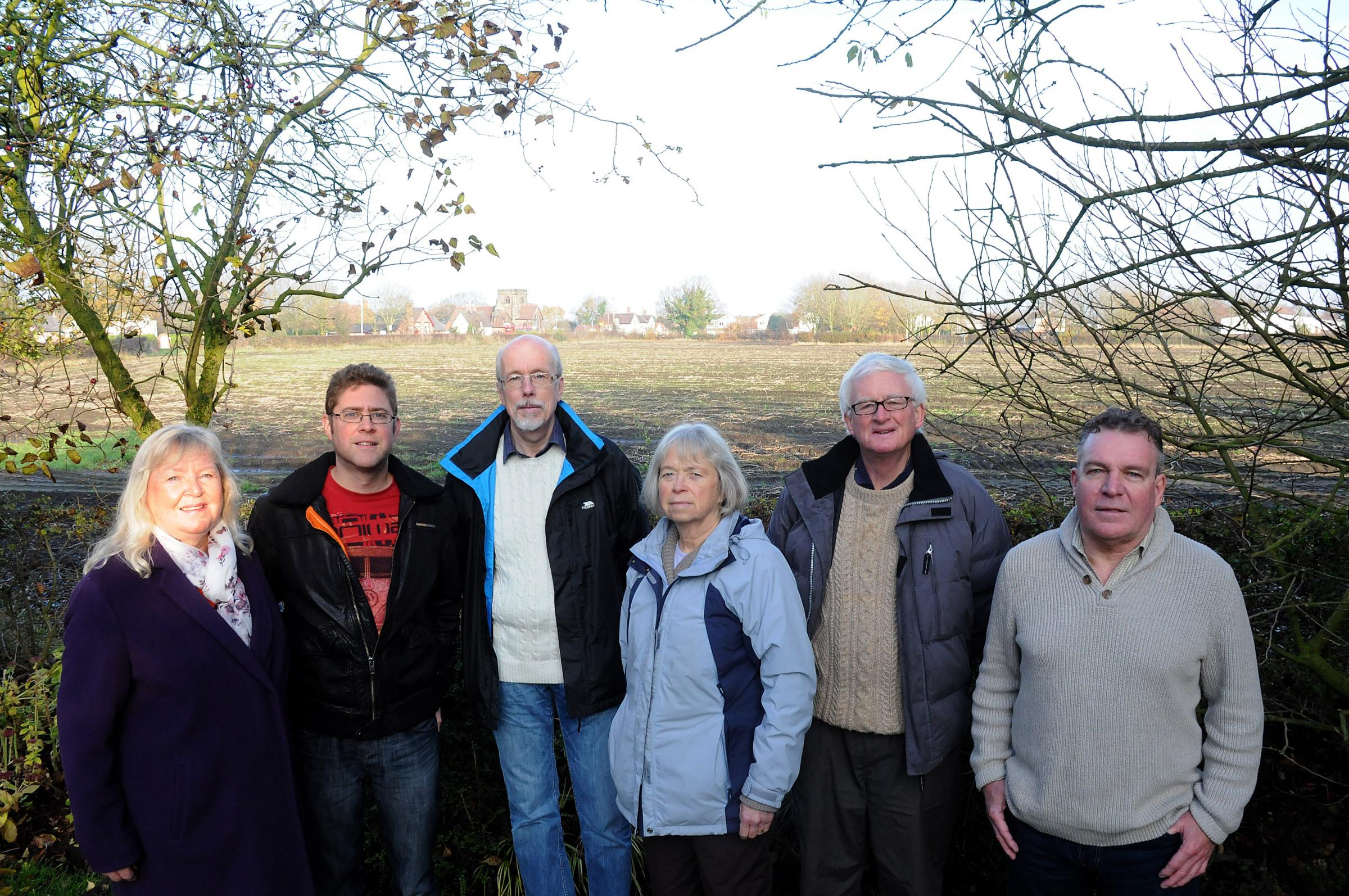 CARE committee members at the site, from left, Carole McNab, Ben Varley, Alan Murray, Liz McAloon, Kevin McAloon and Mark Eardley