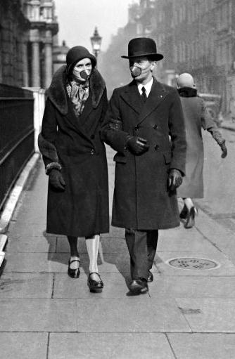 Warrington Guardian: A couple wear masks as they go for a stroll at the time of the 1918 Spanish Flu epidemic