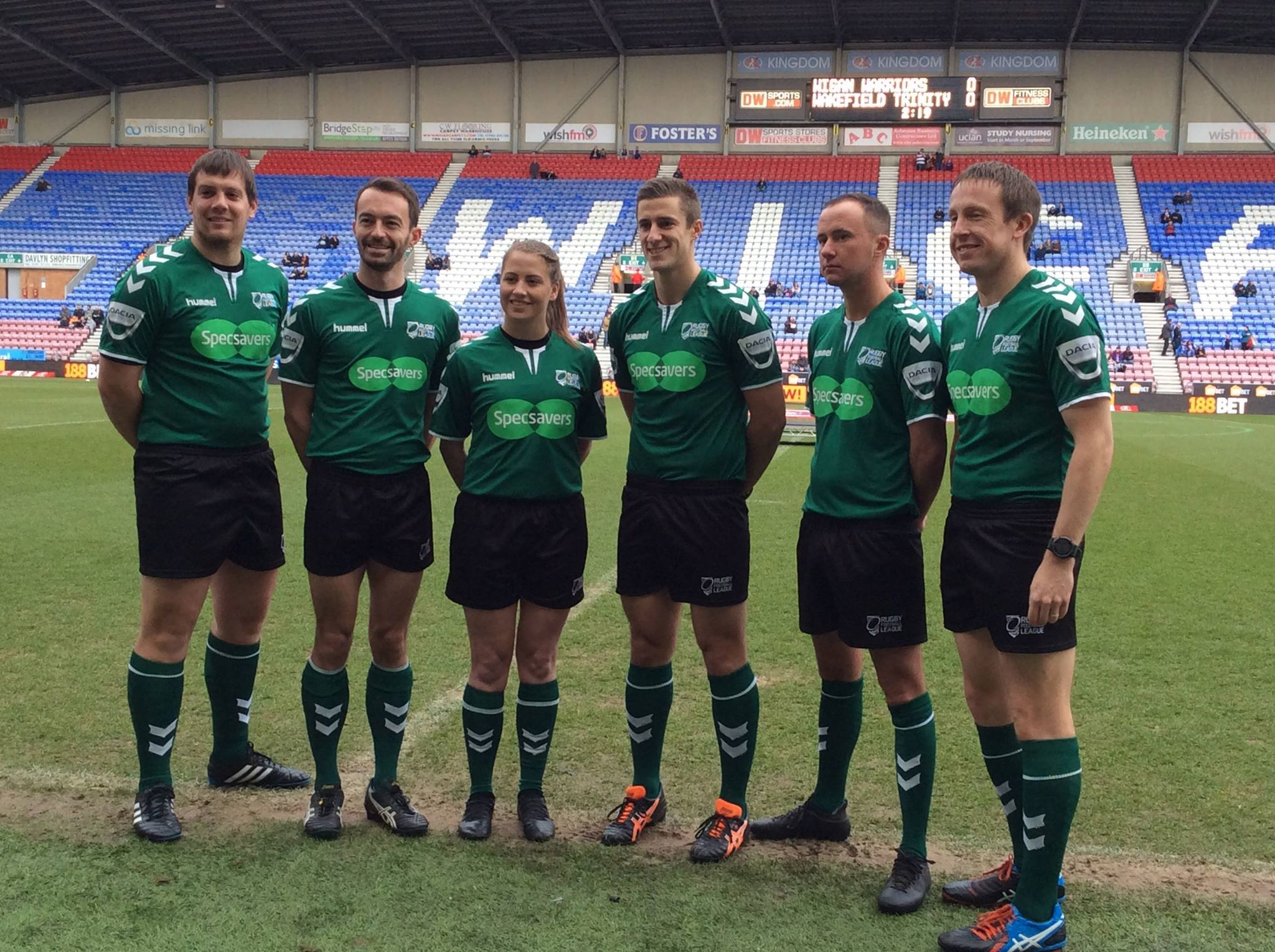 Historic moment as Tara Jones lines up with the team of match officials at yesterday's Wigan v Wakefield game