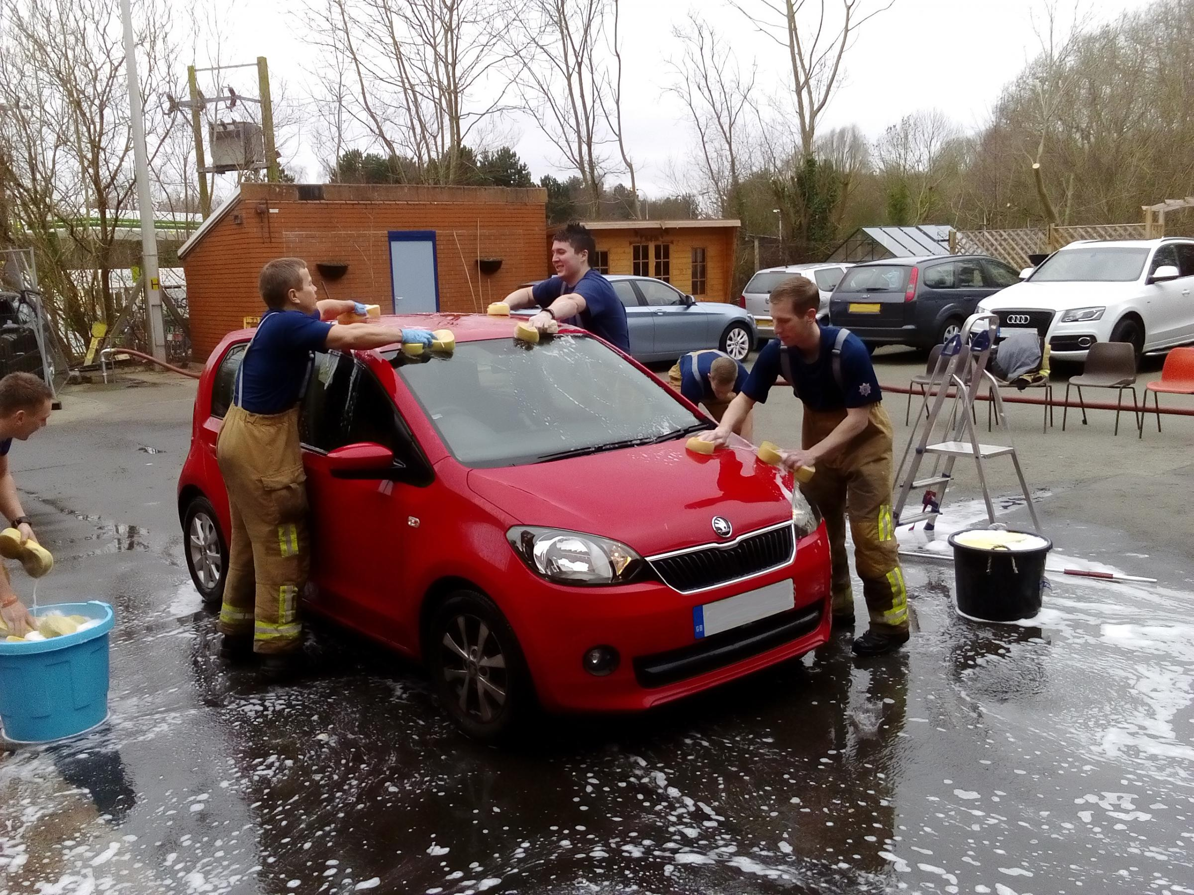 The Birchwood fire fighters washing cars last year