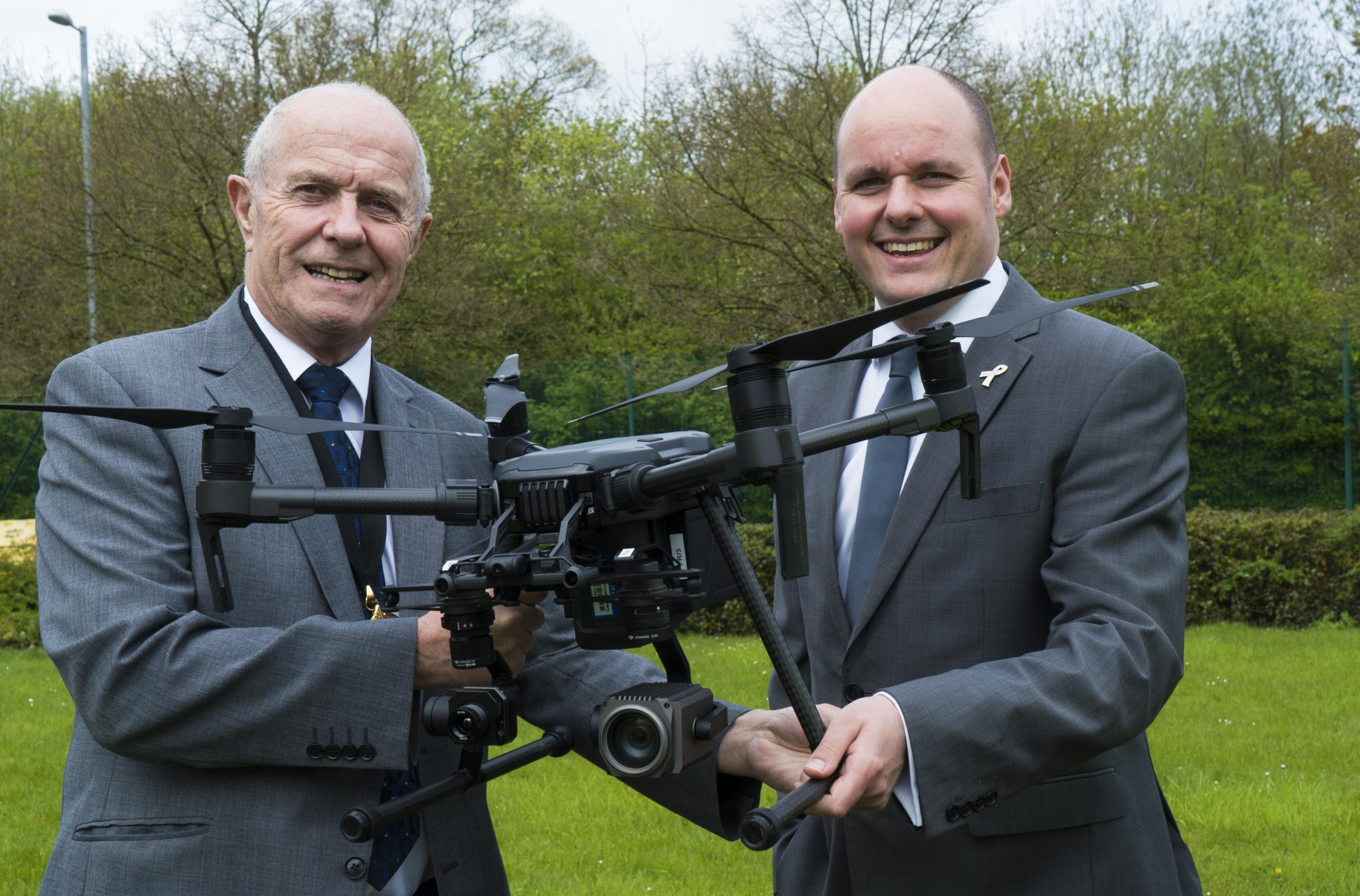 Cheshire Fire Authority chairman Bob Rudd and police and crime commissioner for Cheshire David Keane with the new £25,000 drone.