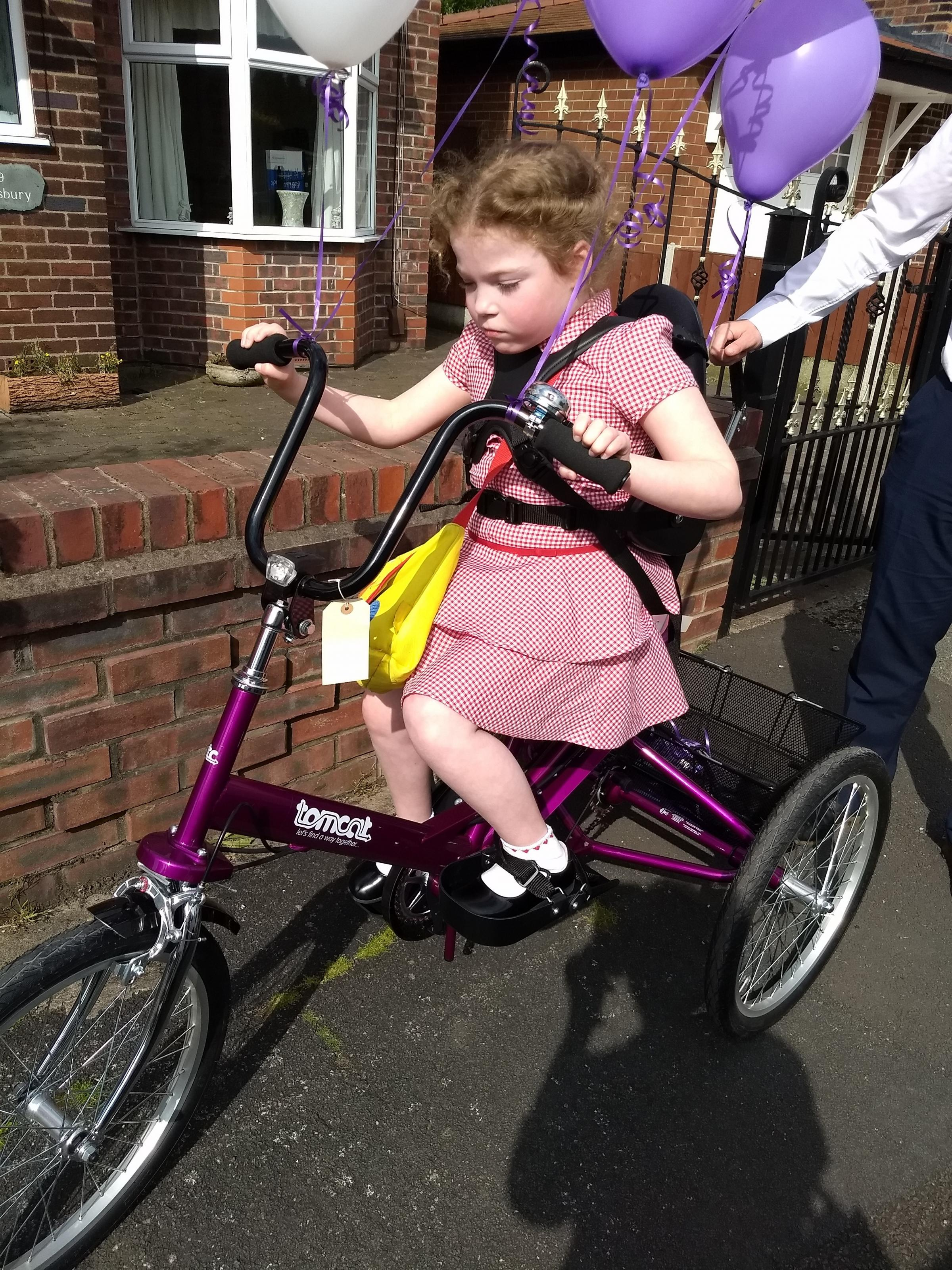 Seven-year-old Evie Chapman with her new Tomcat Fizz Trike, purchased with the help of the Steve Morgan Foundation.
