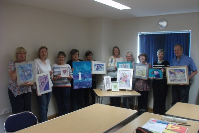 Members of Sue Cartwright's art classes held at the Olive Tree