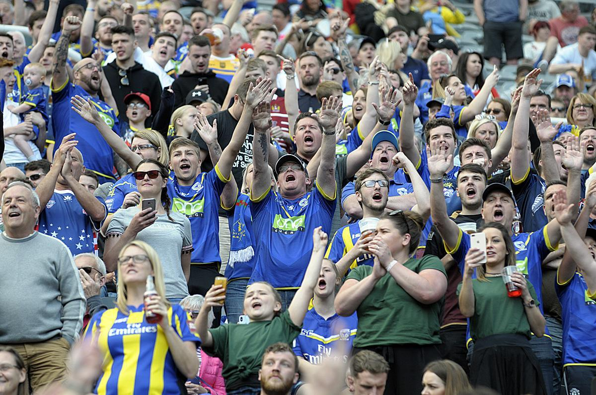 Warrington Wolves fans supporting their team against Wigan Warriors during Magic Weekend at Newcastle United's St James' Park. Picture by Mike Boden