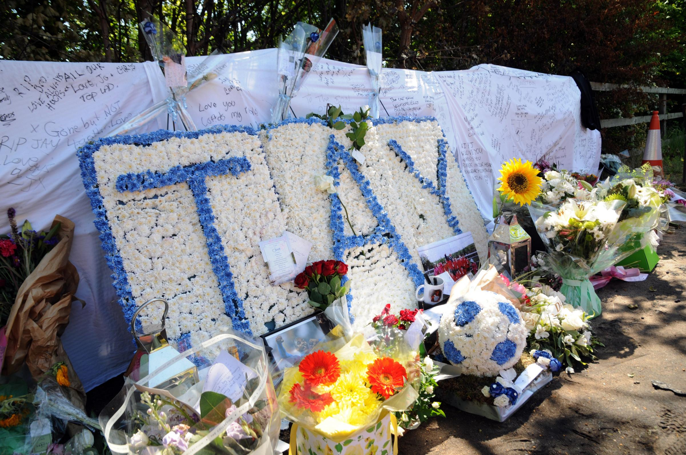 Floral tributes to Jlloyd Samuel at crash scene