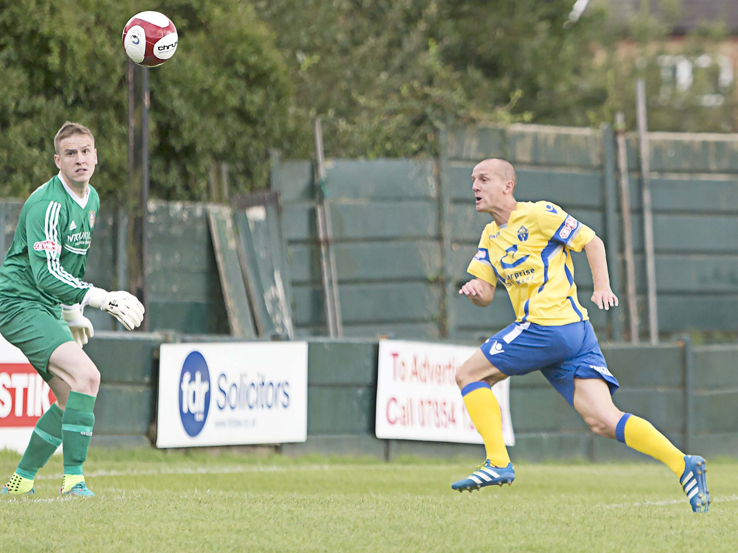 Tony Gray scores for Warrington Town when they last welcome opening day opponents Farsley Celtic to Cantilever Park. Picture by John Hopkins
