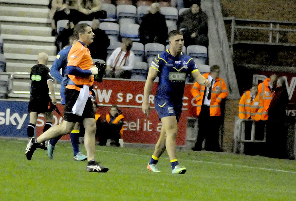 Tom Lineham heads to the sideline after his yellow card against Wigan. Picture: Mike Boden