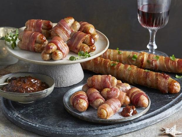 Aldi is launching FOOT-LONG pigs in blankets this Christmas. Pic credit: Aldi