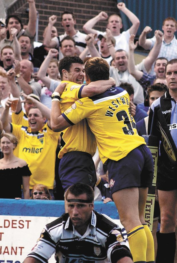 Warrington Guardian: Richie Mathers celebrates with Ben Westwood after a Wolves try against Hull at Wilderspool in 2002