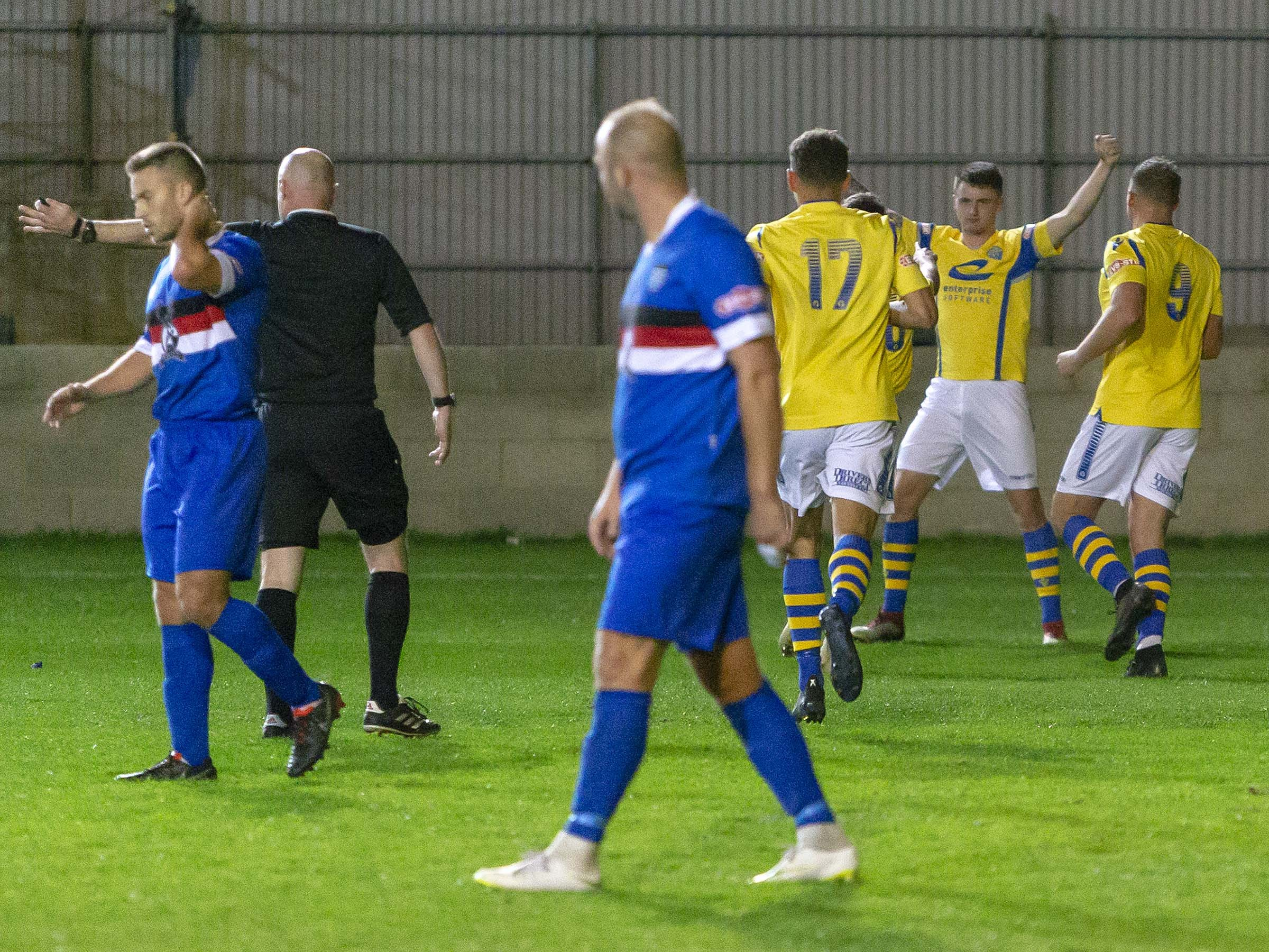 Yellows players celebrate Jack Mackreth's winning goal at Whitby Town last night, Picture by John Hopkins