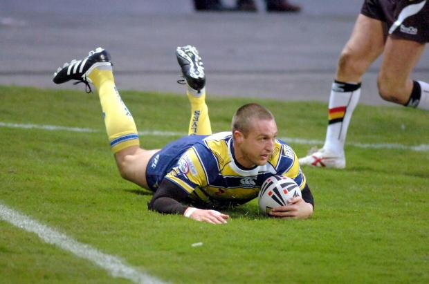 Warrington Guardian: Chris Hicks touches down during Friday's 58-22 win at Bradford.