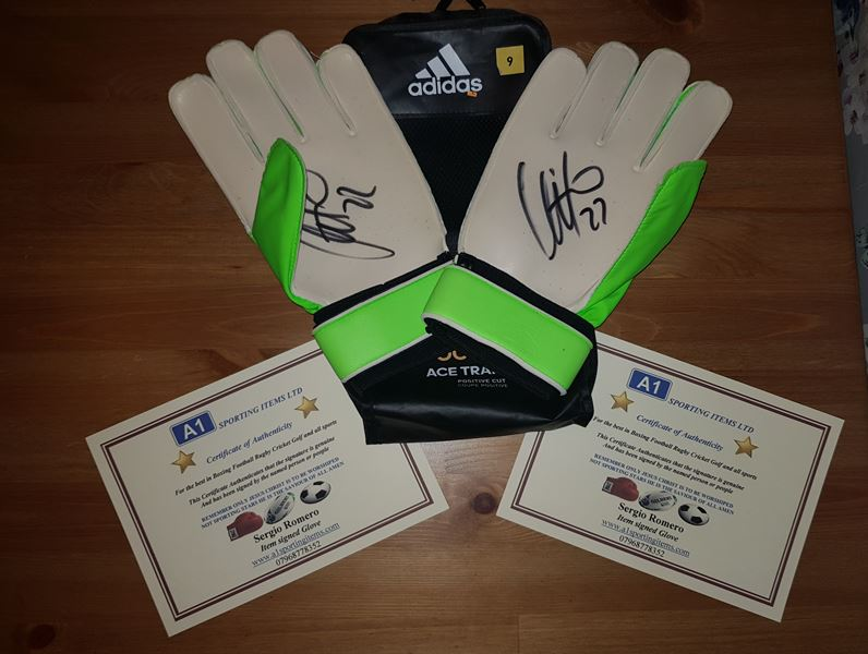 These football gloves have been signed by Manchester United star Sergio Romero