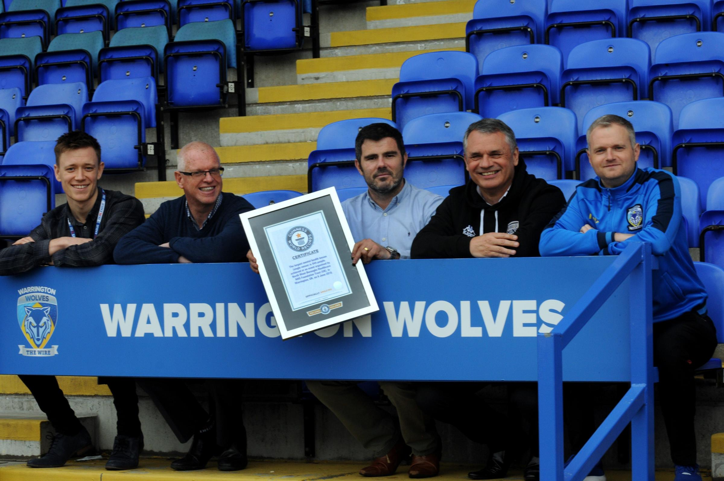 From left, Liam Parker, Rugby League Cares, Simon Barber, chef executive Northwest Boroughs Healthcare, Karl Fitzpatrick, Warrington Wolves chief executive, Dr Phil Cooper, nurse consultant, and James Howes from the Wolves Foundation