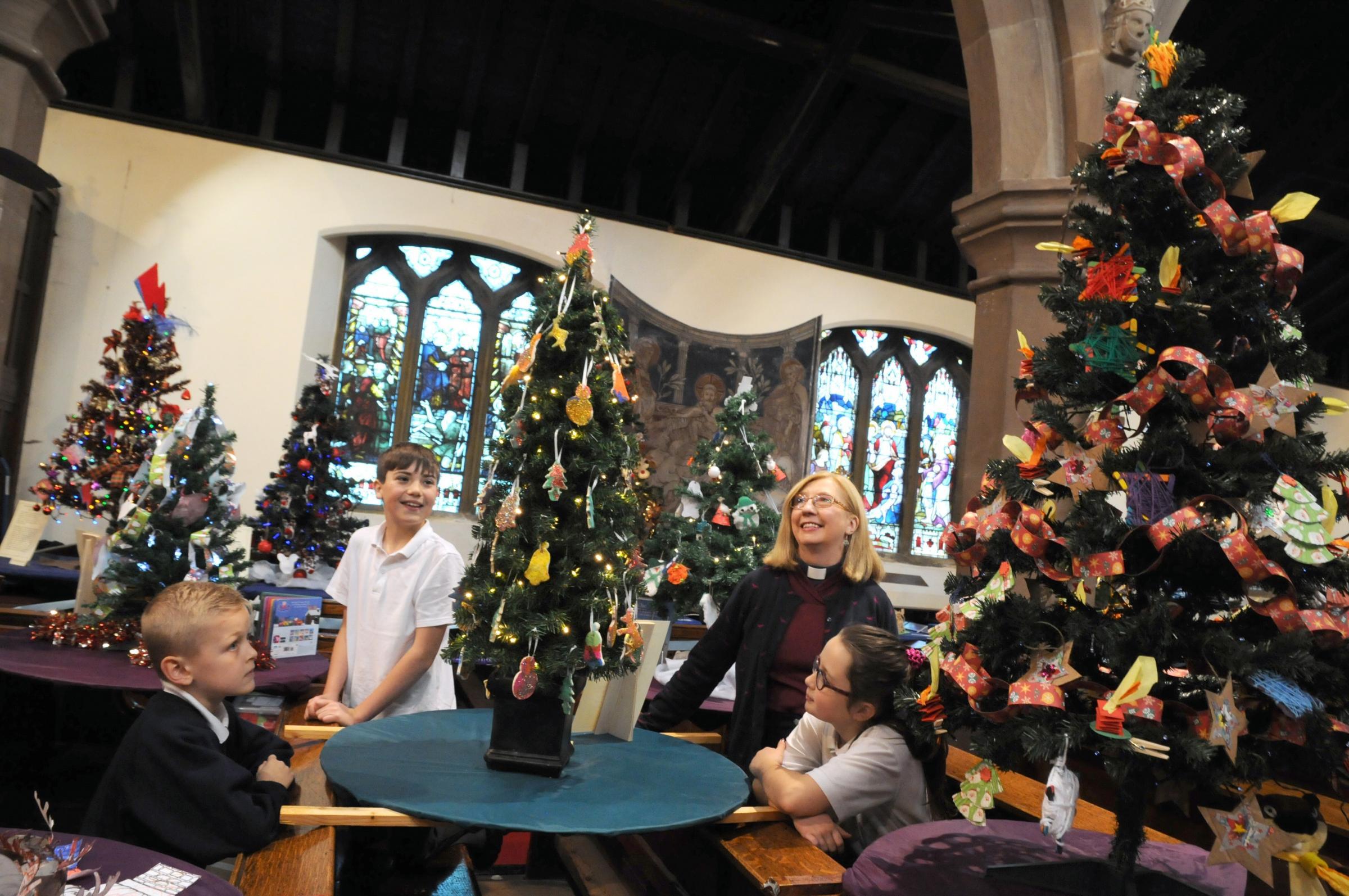 St Mary's Church Lymm christmas tree festival l to R  devon Forster-Barnes , hayden Brown , summer Murphy with Rev Bev.
